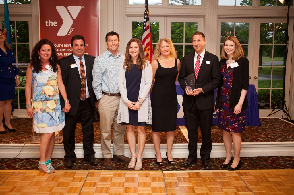 The Middletown Family YMCA staff and their spouses happily accepted the Community Builder Award.