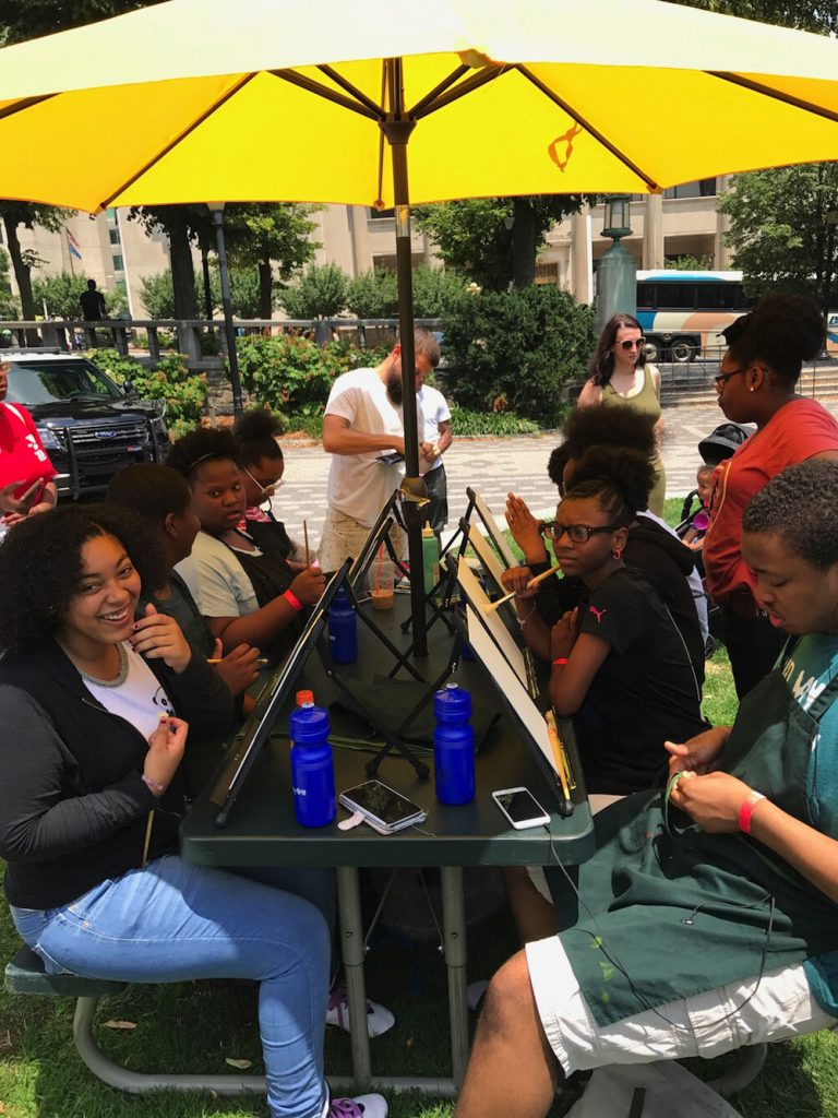 Central YMCA participants painting in Rodney Square.